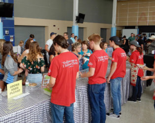 Serving with Grace: Students Earn their Way at Harvest Festival